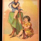 UNION PACIFIC TEA CO. Victorian Trade Card - Two girls playing w/ very long musical instrument