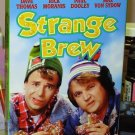 STRANGE BREW VHS STARRING DAVE THOMAS RICK MORANIS PAUL DOOLEY COMEDY  (B47)