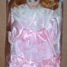 Treasures in Lace Genuine Porcelain Doll in Pink and White Dress