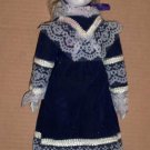 Porcelain Doll in Dark Blue Dress