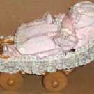 Musical Doll in Wicker Basket Carriage Brahms Lullaby