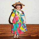 "Vintage Porcelain  8"" Girl Doll with Multi-Colored Dress Loose Used"