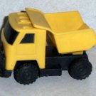 Yellow and Black Plastic Dump Truck Loose Used