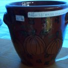 Eldreth Pottery Redware crock with little handles and pumpkin design on it