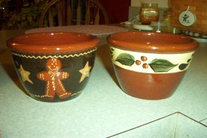 Eldreth Pottery redware dip dish with a Christmas ivy design on it