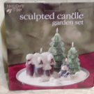 "Sculpted Candle Garden Set a cottage, 2 Cmas trees and snowman w/plate 10"" /25.40cm Dia Price:9.95"