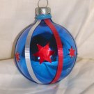 HandCrafted Blue Glass Cmas Ball Ornament w/Red Stars & Red and Silver Ribbin Design Price: 3.95
