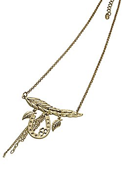 A gold plated leaf charm hangs from two golden chains