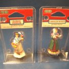 Lemax flower peddler poly-resin figurine and caroller woman village collection figures