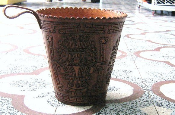 Typical leather basket,hand carved with Inka designs