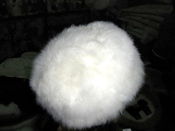 White fur hat, a furry cap made of Babyalpaca pelt