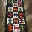 Hand-weaved colorful rug from Peru, green runner with Inca signs