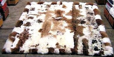 White and brown baby alpaca fur rug with very strong spots, 80 x 60 cm