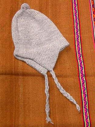 White peruvian Chullo,woolly hat made of alpaca wool
