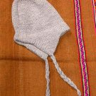 White peruvian Chullo,woolly hat made of alpaca wool