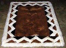 Brown alpaca fur rug with white Ornaments, 80 x 60 cm
