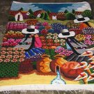 Peruvian motive wall rug flowers in the Andean
