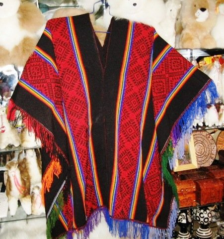 Typical peruvian red Poncho with stripes, Inca designs