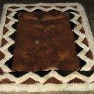 Brown alpaca fur rug with white Ornaments, 90 x 60 cm