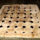 Light brown alpaca fur carpet with black rhombus designs, 150 x 110 cm