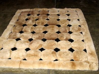 Light brown alpaca fur carpet with black rhombus designs, 300 x 280 cm