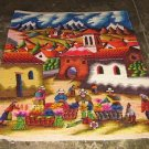 Peruvian motive wall rug Marketplace in the Andes