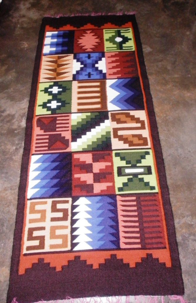 Peruvian hand weaved wool rug with native geometric designs