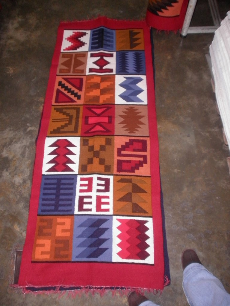 Peruvian hand weaved red wool rug with native geometric designs