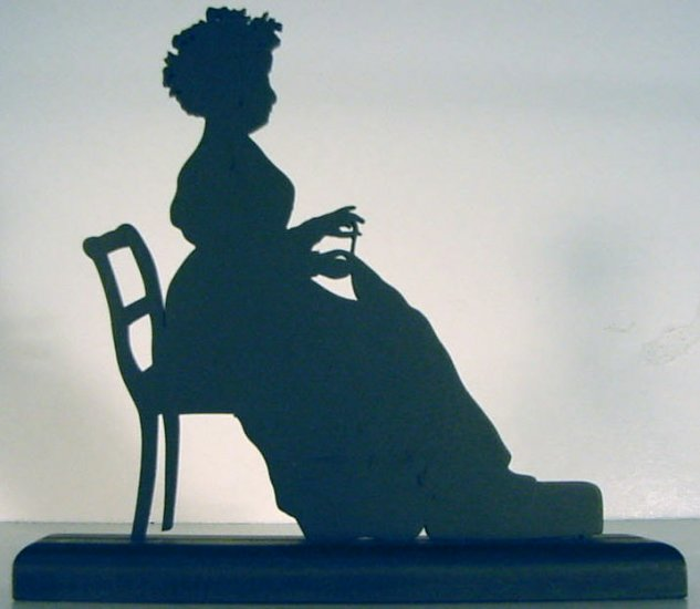 Woman Hand Sewing Decorative Wood Silhouette.