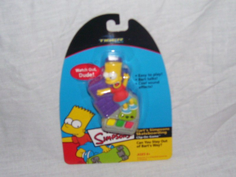 BART SIMPSON'S SKATEBOARDING CLIP ON GAME NEW! FROM 2002