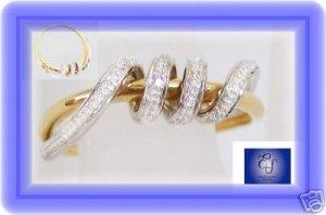 18k 2-tone gold right hand diamond designer ring. Size 7