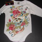 "NEW WHITE LONG SLEEVE TATTOO STYLE ONESIE OF A SKULL WITH DAGGER ""LOVE KILLS SLOWLY""."