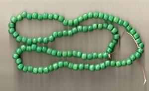 Crow Beads Glass Opaque Green Strand of 100 9x6 mm