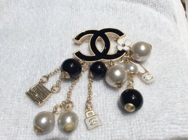 Chanel brooch CC with charms. Hallmarked authentic