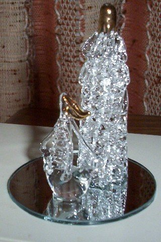 Lighthouse and sailboat spun glass figurine