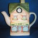 DECORATIVE TEA POT AS SHOWN~SCHOOL WITH CLOCK