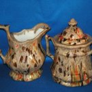 LARGE BROWN CREAMER AND COVERED SUGAR BOWL AS SHOWN