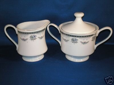 FLORAL CREAMER AND COVERED SUGAR BOWL AS SHOWN