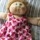 Cabbage Patch Kid in pink dress