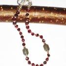 ST509 Garnet Bracelet in Sterling Silver