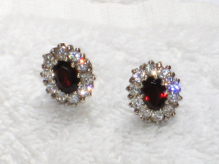 ER077       Ruby Studs Surrounded by CZ in Sterling Silver