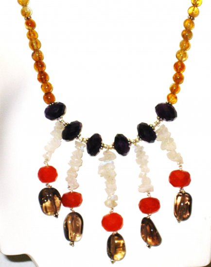 NK011       Citrine strand with Amethyst, Carnelian, Moonstone, and Smoky Quartz Center.