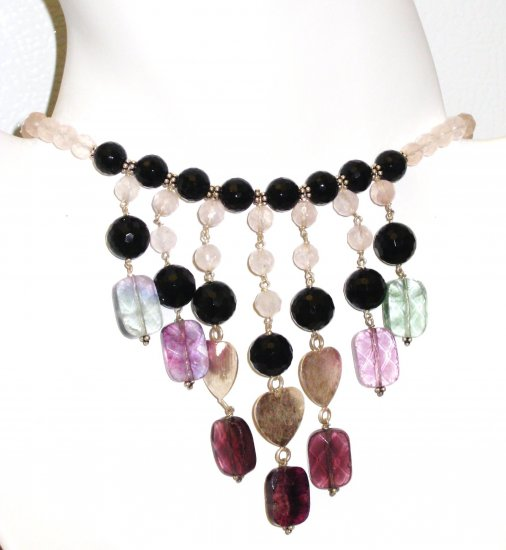 NK015       Multi-Stone Necklace in Sterling Silver with a Rose Quartz Strand.