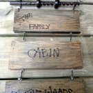 Wall hanging from reclaimed farm tools and wood. Family