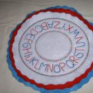 HANDMADE OVAL CANDLE MAT RED WHIT BLUE WITH ALPHABET EMBROIDERY DESIGN