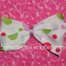Adorable Boutique Multi-Colored Polka Dots on an alligator clip