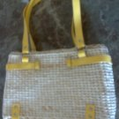 Straw purse with faux leather yellow straps
