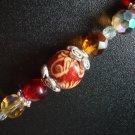 Ray of Sunshine Bracelet: Orange, Red and Wooden Beads