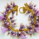 Purple Trumpet Flower Pearl Bead Gold Tone Cha Cha Bracelet