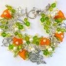 Fairy and Four Leaf Clover Green Orange Flower Charm Bracelet